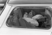 Young lady asleep in a Mini