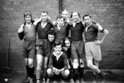 Towcester Grammar School Rugby Team forwards - John Hendy in the second row, with scrumcap