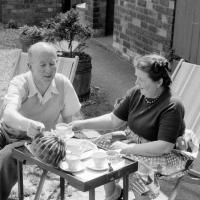 Katie and Bernard having tea in the garden at Cottingham