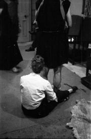 Greta adjusting a costume at the Masque