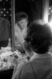 Greta applying makeup, at the Masque