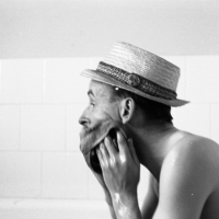 John in the bath. In a hat.