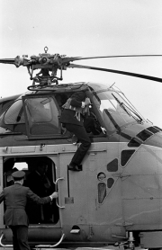 Duke of Edinburgh climbing into the helicopter