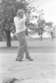Robinson playing golf