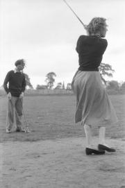 Robinson playing golf