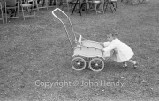 Little girl and pram