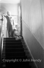 Mary Watson at the top of the stairs