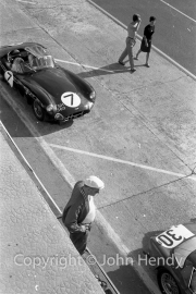 Qualifying - #7 Aston Martin DBR1/300 (Roy Salvadori and Jim Clark) in the pits. Also #30 AC Ace Aigle/ Bristol (Andre Wicky and Georges Gachanang)