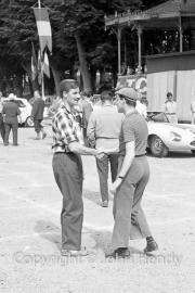 Graham Hill and Gerard Crombac meet at Scrutineering