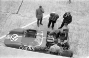 #43 O.S.C.A. Sport 1000 (David Cunningham and Ed Hugus) in the pits from above, with the bonnet open