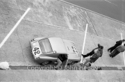 #42 Austin-Healey Sprite Sebring (John K. Colgate Jr and Paul Hawkins) in the pits