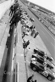 View of the pits, with Triumph TR4 S - #25 (Marcel Becquart and Mike Rothschild), #26 (Peter Bolton and Keith Ballisat), #27 (Les Leston and Rob Slotemaker).