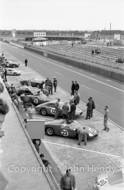 Ferraris in the pits - #11 Ferrari 250 TRI/61 (Willy Mairesse and Mike Parkes). #12 Ferrari 250 GT Experimental (Fernand Tavano and Giancarlo Baghetti). #23 Ferrari 246 P (Wolfgang von Trips and Richie Ginther).