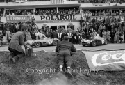 The start, with the drivers climbing into their Aston Martin DBR1/300's - Jim Clark in #5, Roy Salvadori or Tony Maggs in #4