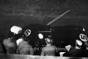 Aston Martin pit stop at night - Ron Flockhart, driver of #5 Aston Martin DBR1/300