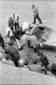 Aston Martin pit stop, big leak under the rear, #4 Aston Martin DBR1/300 (Roy Salvadori and Tony Maggs)