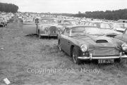 Aston Martin DB4 and our Jaguar in the car park