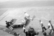 Aston Martin pit stop, withdrawing #4 Aston Martin DBR1/300 (Roy Salvadori and Tony Maggs). Diagnosis split fuel tank.