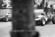 Formula 1 - #10 BRM P57 (Graham Hill) passing the pits