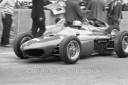 Formula 1 - Ferrari 156 (not sure of the driver. Perhaps #38 Bandini?) pulling out of the pits