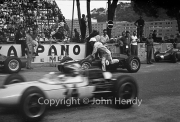 Formula 1 - #8 BRM P48/57 (Richie Ginther) pushing his car into the pits, with #34 Lotus-Climax 24 (Innes Ireland) passing