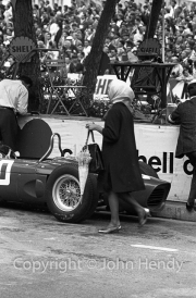 Young lady with umbrella in the pits after the race