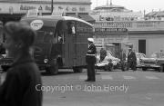 Police directing Cooper team truck