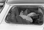 Young lady asleep in the back of a Mini