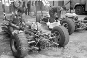 Formula 1 - #6 Lotus-Climax 33 (Mike Spence) and #26 Lotus-Climax 15 (Brian Gubby), engines exposed