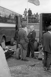 Colin Chapman (back to the camera)