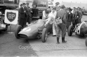 Formula 1 - #7 Aston Martin DBR4/250 (Maurice Trintignant) in the paddock, with Jill Harris etc