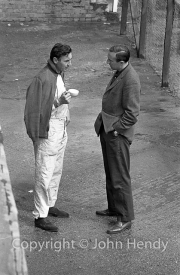 Roy Salvadori and Jack Shears(?) talking over a cup of tea
