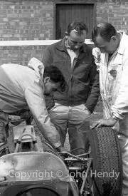 Formula 1 - Lola and John Surtees (probably #14 Lola Mk 4 - Climax V8) in the paddock