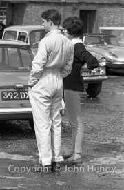 Driver and ladyfriend in the paddock
