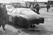 Sportscars - #35 Aston Martin DB4 GT Zagato 0182/R 1VEV (Mike Salmon) on a jack in the paddock