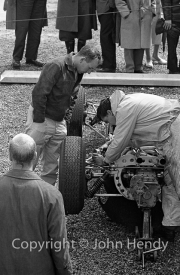 Formula 1 - Lola and John Surtees (probably #14 Lola Mk 4 - Climax V8) in the paddock