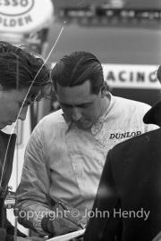 Jack Brabham signing an autograph