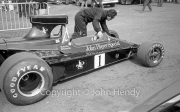 F1 - #1 Lotus-Cosworth 76 (Ronnie Petersen) being wheeled through the paddock