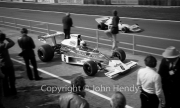 F1 - #6 McLaren-Cosworth M23 (Denny Hulme) leaving the pits