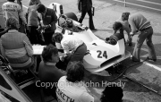 F1 - #24 Hesketh-Cosworth 308 (James Hunt) in the pits, Lord Hesketh looking on