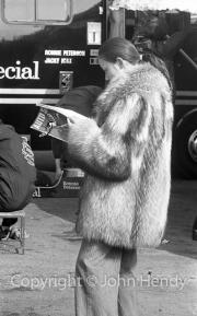 Lady in fur coat in the Lotus paddock