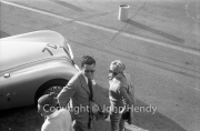 "#7 team XK Jaguards. ""D"" car - XK120 DHC, Eric Brown. Plus a young lady."