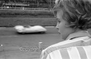 A young lady watching the racing
