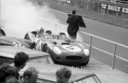 Team #1 Jaguar Drivers A, Car A - Jaguar E-Type (Roger Mac) returning to the pits, smoking considerably