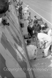 Formula 1 - View into the pits, #7 Cooper T53 - Climax S4 (Stirling Moss)