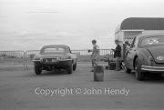 Touring cars - E-Type Jaguar in the paddock (could be #37, Bruce McLaren's car)