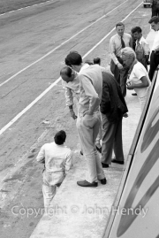 Chris Nixon and Stirling Moss in the pits