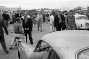 Stirling moss on his scooter in the paddock