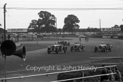 #126 1927 Vauxhall and others rounding Woodcote