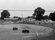 Cars coming round Woodcote corner